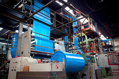 Film extrusion machines for the manufacture of rubbish bags